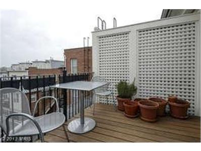 Beasley Real Estate lists unit with rooftop terrace